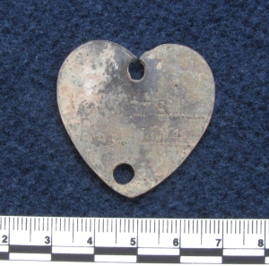 Heart-shaped dog tag stamped with registration 104 and district 78