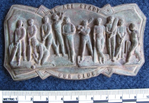 Cricket buckle depicting a cricket team and the words WE ARE READY OUR CLUB