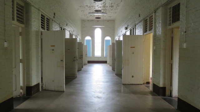 First floor hall, with open cell doors.