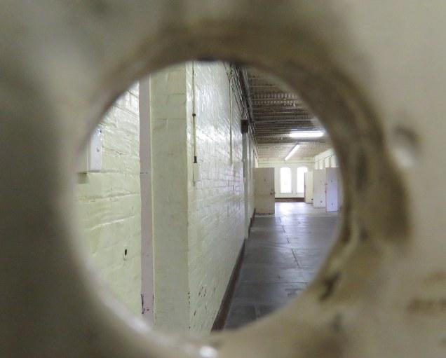 Through a door peephole.