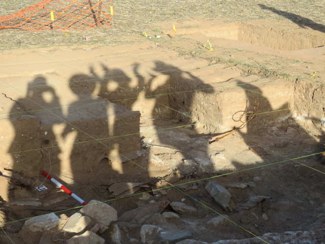 Shadows of archaeologists dancing.