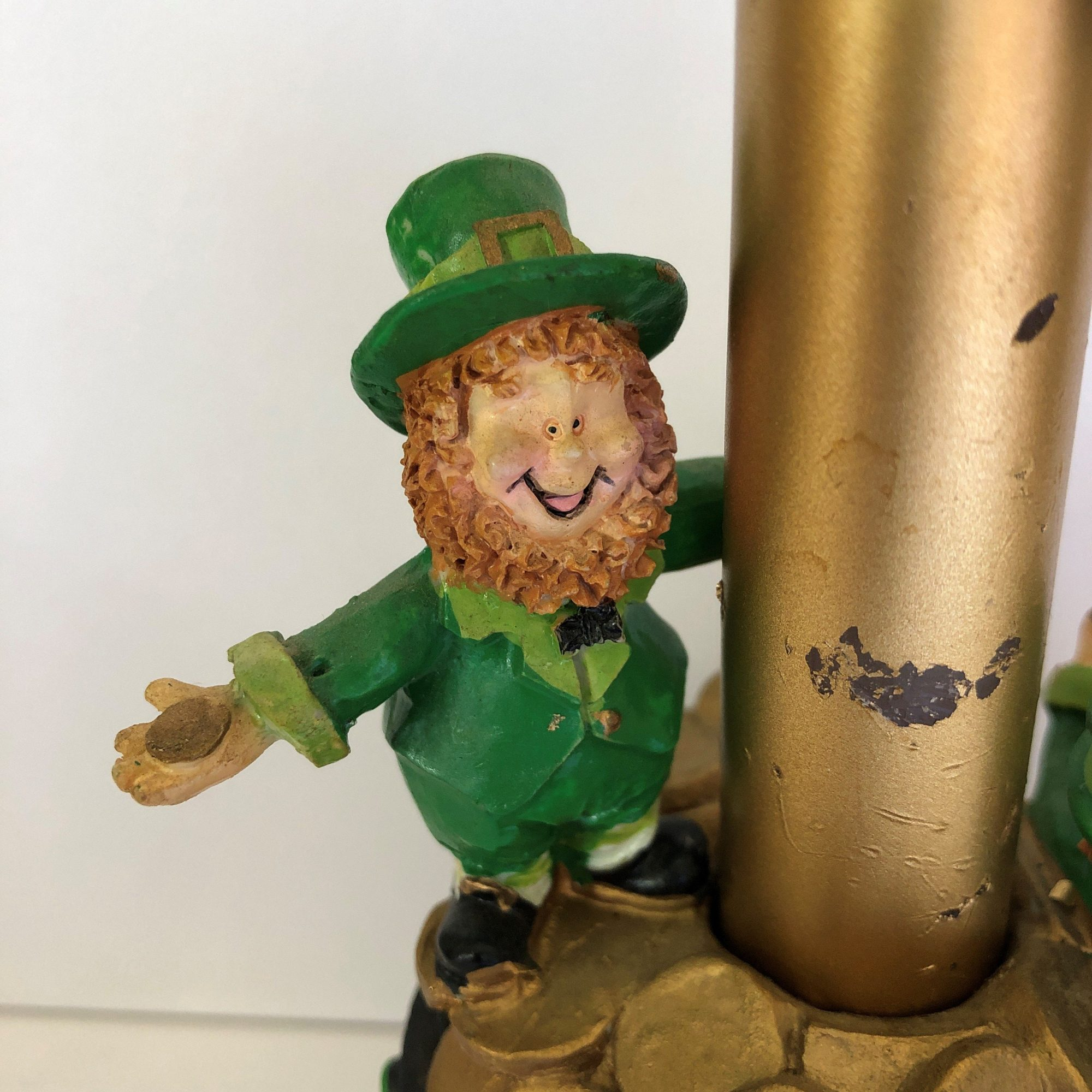 Leprechaun standing on pot of gold